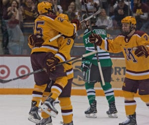 Kloos and Sheehy celebrate with Szmatula as he puts Minnesota cup 1-0